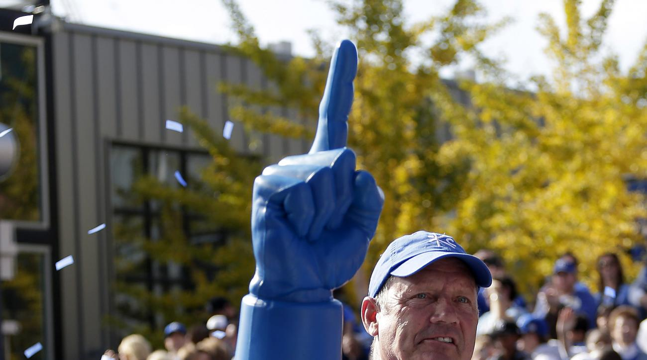 Former Kansas City Royals player George Brett waves to the crowd during a parade celebrating the Kansas City Royals winning baseball's World Series Tuesday, Nov. 3, 2015, in Kansas City, Mo. The Royals beat the New York Mets in five games to win the champ