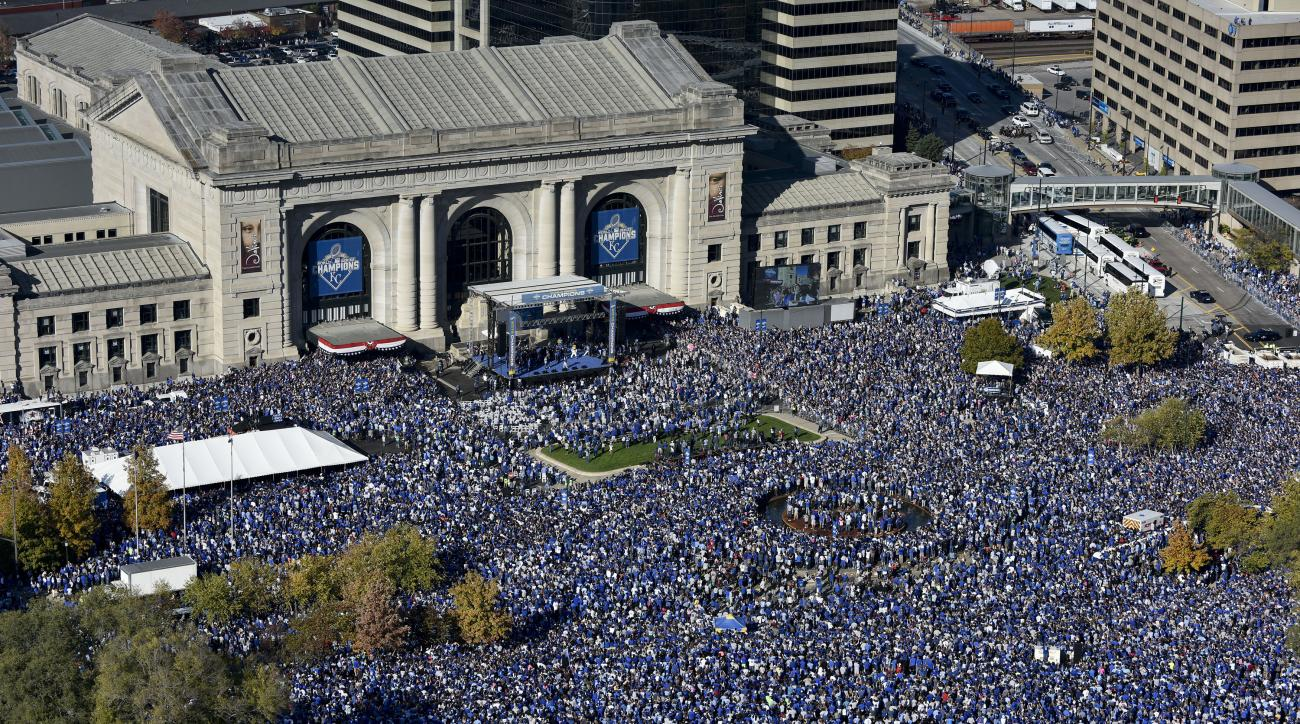 Fans gather for a rally to celebrate the Kansas City Royals winning baseball's World Series at Union Station on Tuesday, Nov. 3, 2015, in Kansas City, Mo. The Royals beat the New York Mets in five games to win the championship. (AP Photo/Reed Hoffmann)