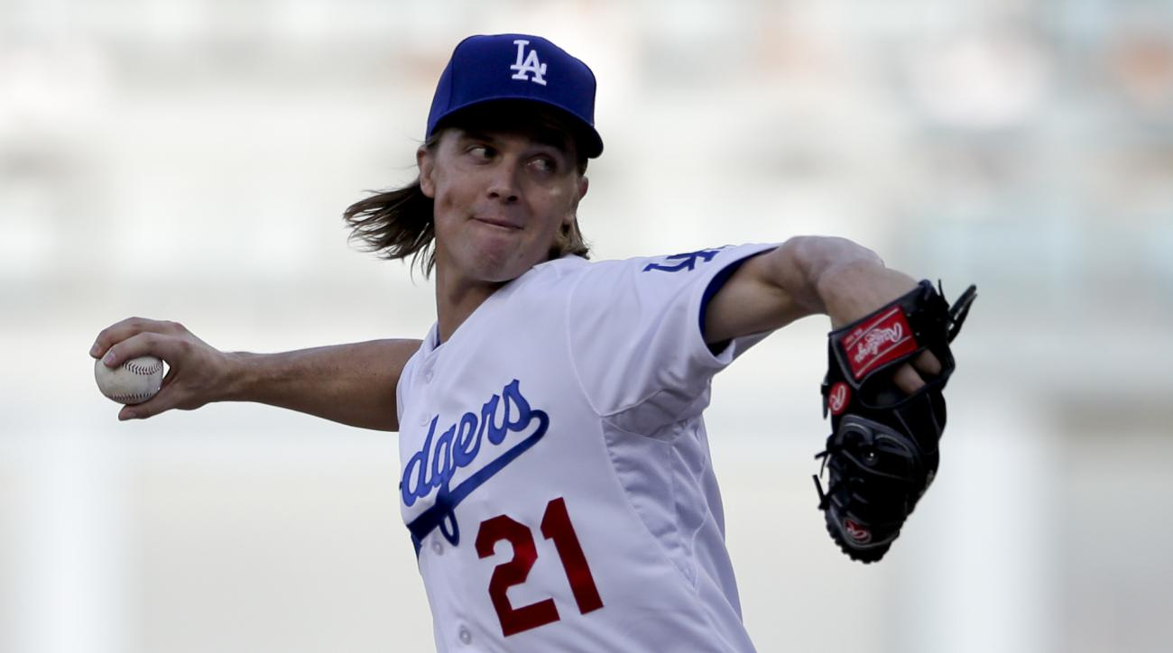 Los Angeles Dodgers starting pitcher Zack Greinke works against a New York Mets batter during the first inning in Game 5 of baseball's National League Division Series Thursday, Oct. 15, 2015, in Los Angeles. (AP Photo/Gregory Bull)