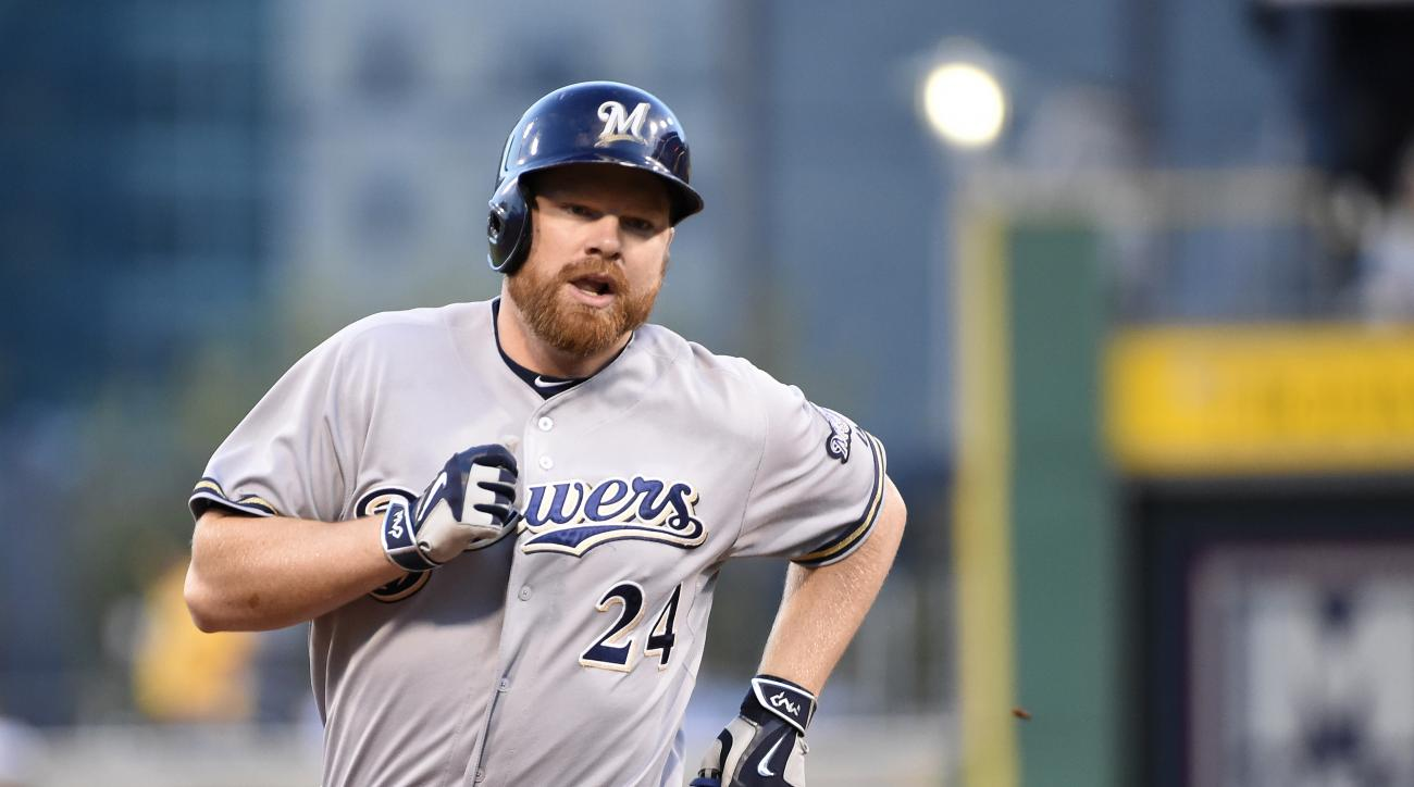 Milwaukee Brewers' Adam Lind trots around the bases after hitting a homerun during a game against the Pittsburgh Pirates, Friday, Sept. 11, 2015, in Pittsburgh.  (AP Photo/Fred Vuich)