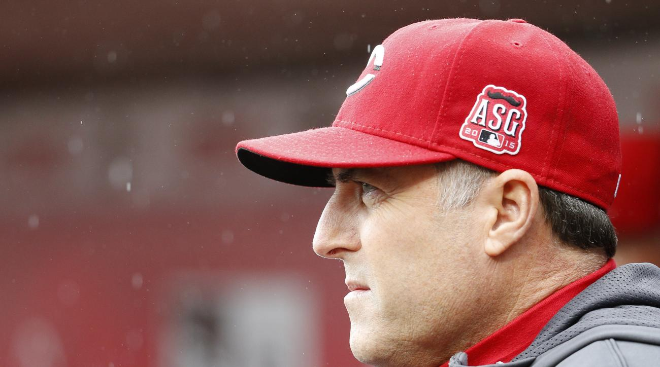 Cincinnati Reds manager Bryan Price stands in the dugout in the fifth inning of a baseball game against the Chicago Cubs, Thursday, Oct. 1, 2015, in Cincinnati. The Cubs won 5-3. (AP Photo/John Minchillo)