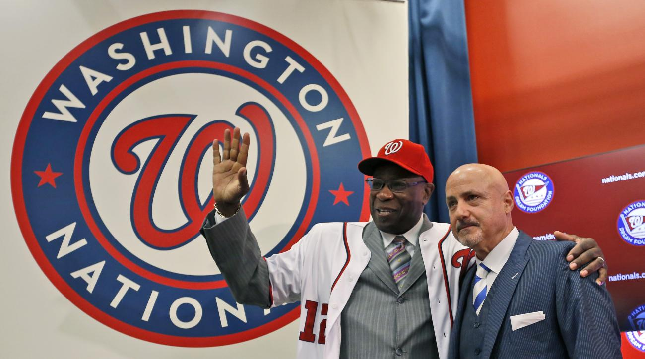 Dusty Baker, left, with general manager Mike Rizzo,  waves after he was presented with his hat and jersey, during a news conference to present Baker as the new manager of the Washington Nationals baseball team, Thursday, Nov. 5, 2015, in Washington. (AP P