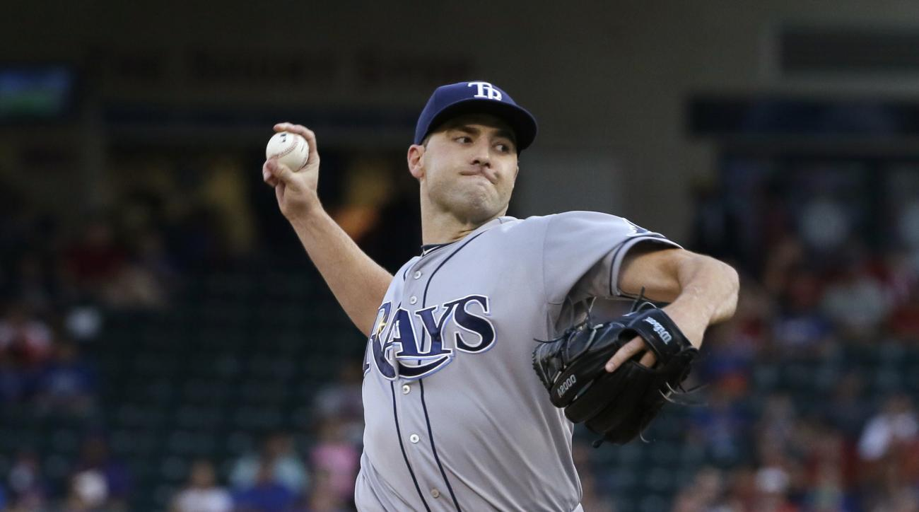 FILE - In this Aug. 14, 2015, file photo, Tampa Bay Rays starting pitcher Nathan Karns throws during a baseball game against the Texas Rangers in Arlington, Texas. The Seattle Mariners and the Rays have completed the first significant trade of the offseas