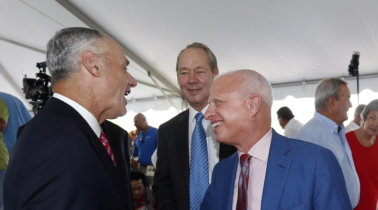 Major League Baseball commissioner Rob Manfred, left, greets Washington Nationals owner Mark Lerner, right,as Houston Astros owner Jim Crane, center,  looks on before a groundbreaking ceremony for the future home of the of Houston Astros and the Washingto