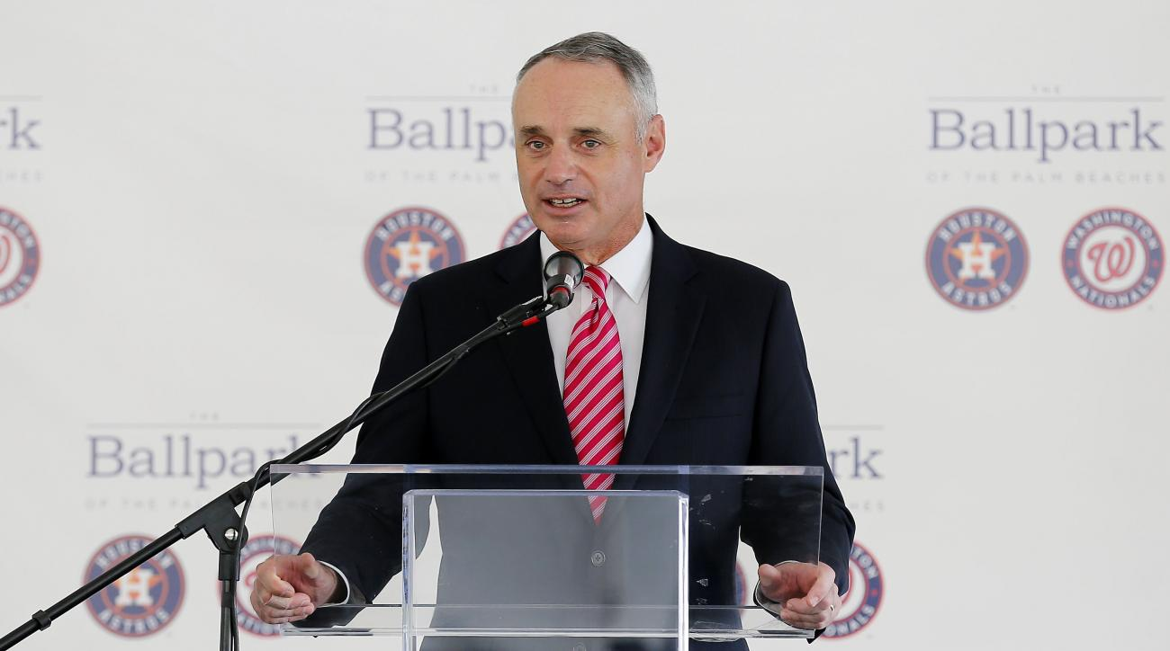 Major League Baseball commissioner Rob Manfred speaks during a groundbreaking ceremony for the future home of the Houston Astros and the Washington Nationals spring training facility on Monday, Nov. 9, 2015, in West Palm Beach, Fla. (AP Photo/Steve Mitche