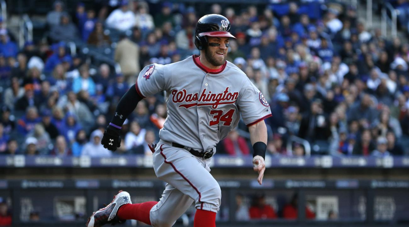 Washington Nationals Bryce Harper, trying for the National League batting title, runs out a ground ball in the seventh inning of a baseball game in New York, Sunday, Oct. 4, 2015. (AP Photo/Kathy Willens)