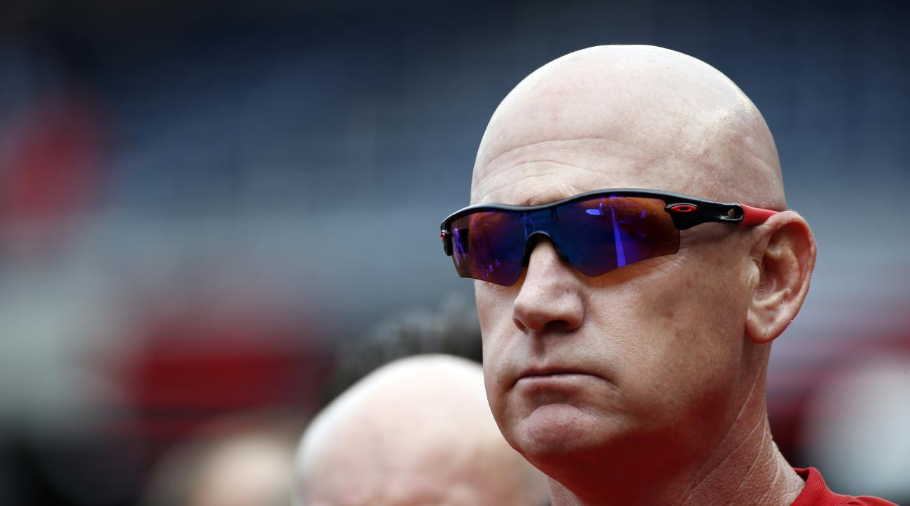 Washington Nationals manager Matt Williams stands during the national anthem before a baseball game against the Cincinnati Reds at Nationals Park, Monday, Sept. 28, 2015, in Washington. (AP Photo/Alex Brandon)