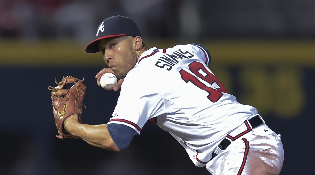 FILE - In this Sept. 30, 2015, file photo, Atlanta Braves shortstop Andrelton Simmons throws to first base for an out on Washington Nationals' Wilson Ramos during a baseball game in Atlanta. The Braves have traded Simmons to the Los Angeles Angels in a de