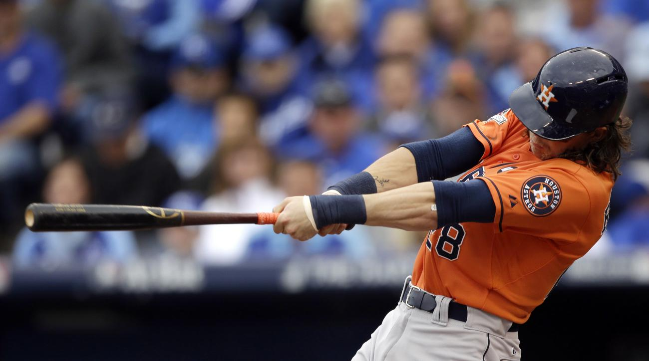 FILE - In this Oct. 9, 2015, file photo, Houston Astros' Colby Rasmus hits a solo home run during the third inning of Game 2 in baseball's American League Division Series against the Kansas City Royals in Kansas City, Mo. A person familiar with the decisi