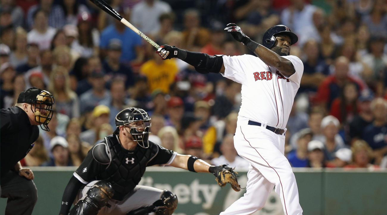 FILE - In this July 30, 2015, file photo, Boston Red Sox's David Ortiz follows through on an RBI double in front of Chicago White Sox's Tyler Flowers during the first inning of a baseball game in Boston.  Ortiz said Wednesday, Nov. 18, 2015, that he will