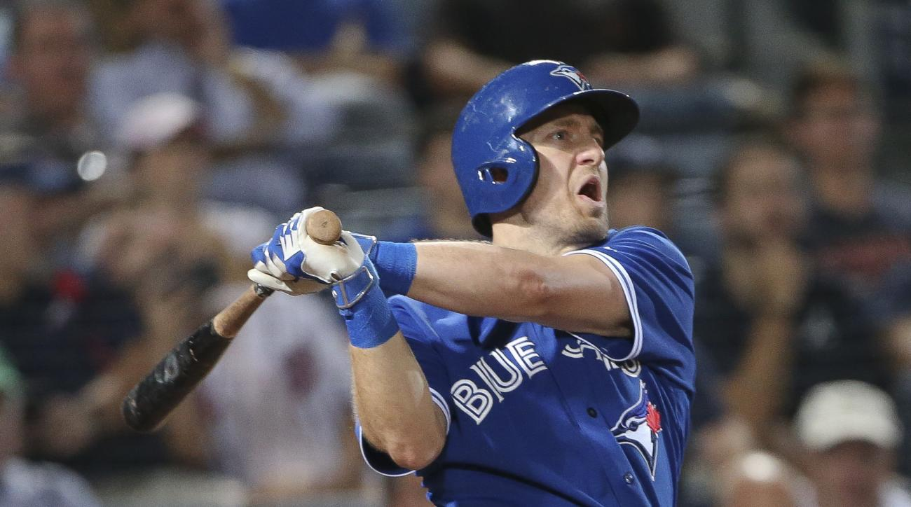 FILE - In this Sept. 17, 2015, file photo, then-Toronto Blue Jays second baseman Cliff Pennington follows through on a three-run home run during the fourth inning of a baseball game against the Atlanta Braves, in Atlanta. Veteran infielder Cliff Penningto