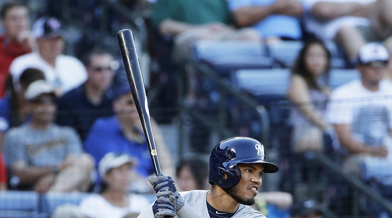 FILE - In this May 23, 2015, file photo, Milwaukee Brewers' Luis Sardinas hits a single in the ninth inning of a baseball game against the Atlanta Braves, in Atlanta. New Brewers general manager David Stearns made a trade for the third straight day, Frida