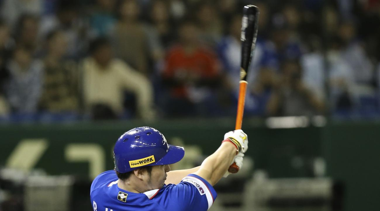 South Korea's Park Byung-ho hits a three-run home run against Team USA in the fourth inning of their final game at the Premier12 world baseball tournament at Tokyo Dome in Tokyo, Saturday, Nov. 21, 2015. (AP Photo/Koji Sasahara)