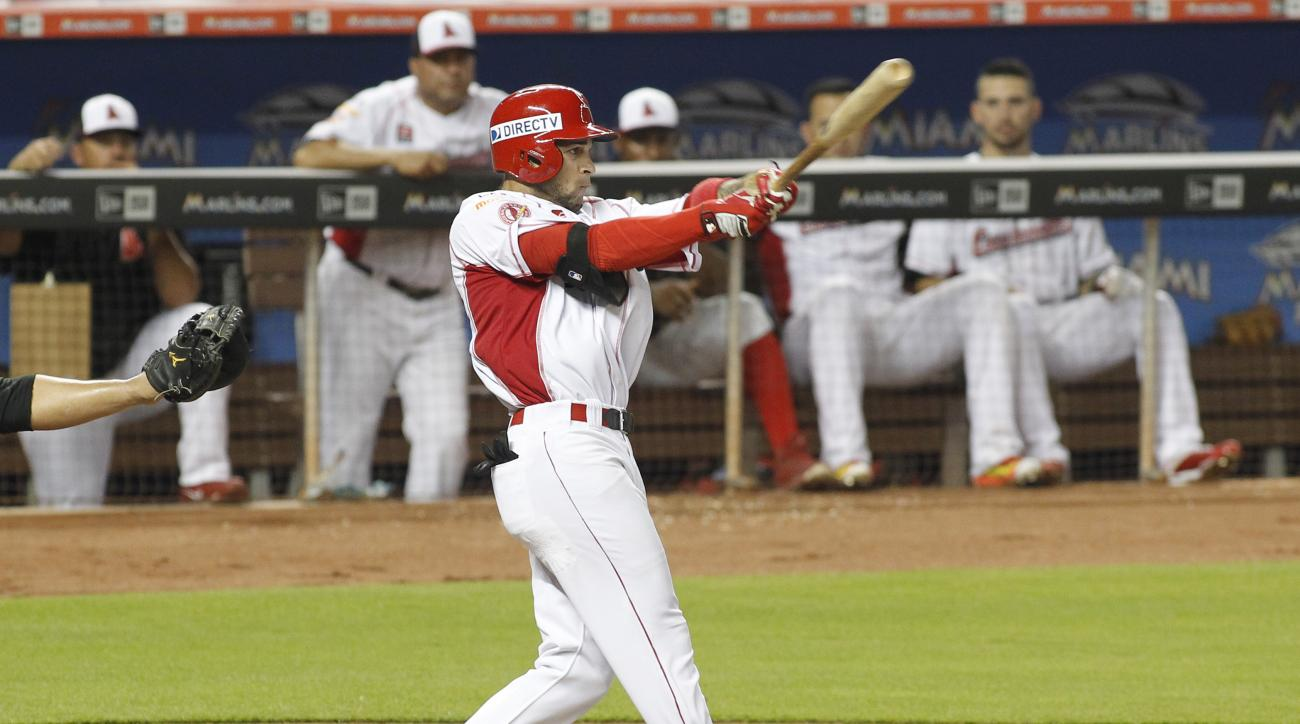 Cardenales' Rubi Silva hits an RBI single against Navegantes during the third inning of a Serie de las Americas baseball game at Marlins Park in Miami, Saturday, Nov. 21, 2015. (AP Photo/Joe Skipper)