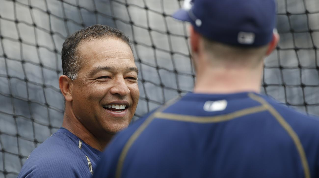 San Diego Padres coach Dave Roberts prior to a baseball game against the Arizona Diamondbacks Saturday, June 27, 2015, in San Diego.  (AP Photo/Lenny Ignelzi)