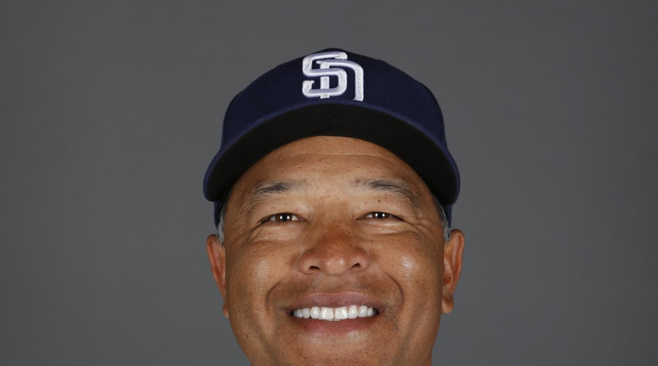 File- This 2015 file photo of Dave Roberts of the San Diego Padres baseball team. A person familiar with the decision has told The Associated Press that the Los Angeles Dodgers will name Roberts as their new manager.  (AP Photo/John Locher, File)