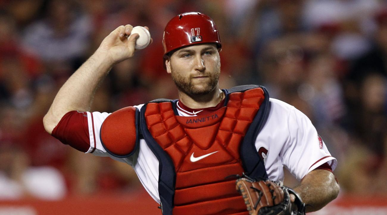 FILE - In this Tuesday, July 21, 2015 file photo, Los Angeles Angels catcher Chris Iannetta throws out Minnesota Twins' Trevor Plouffe, after striking out during the sixth inning of a baseball game in Anaheim, Calif. annetta signed a one-year contract wit