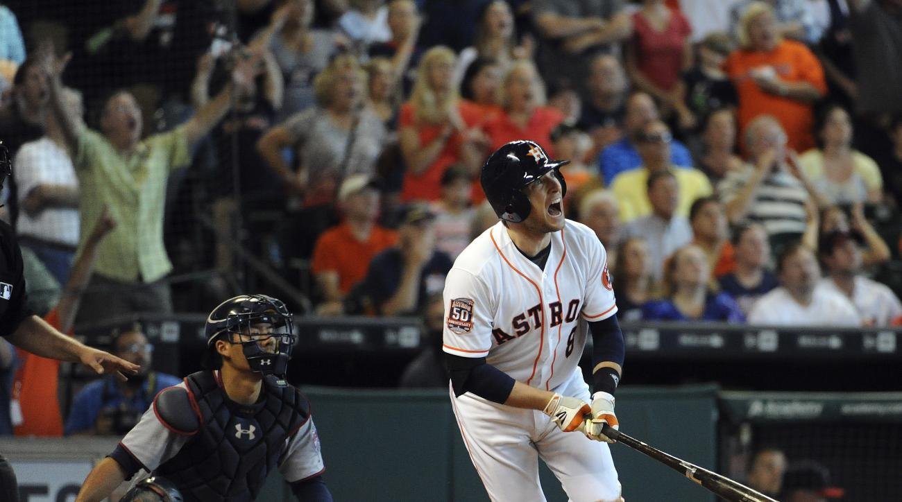 FILE - In this Sept. 6, 2015, file photo, Houston Astros' Jed Lowrie (8) watches his grand slam in the seventh inning of a baseball game against the Minnesota Twins,  in Houston. Infielder Jed Lowrie has been acquired by the Oakland Athletics from the Hou