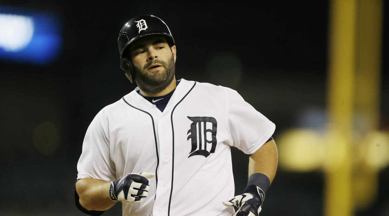FILE - In this Sept. 21, 2015, file photo, Detroit Tigers catcher Alex Avila rounds the bases after his solo home run in the third inning in the second game of a baseball doubleheader against the Chicago White Sox, in Detroit. Free agent catcher Alex Avil