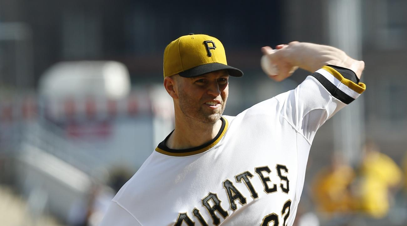 Pittsburgh Pirates' J.A. Happ (32) thrws against the Cincinnati Reds in the first inning of a baseball game, Sunday, Oct. 4, 2015, in Pittsburgh. (AP Photo/Keith Srakocic)