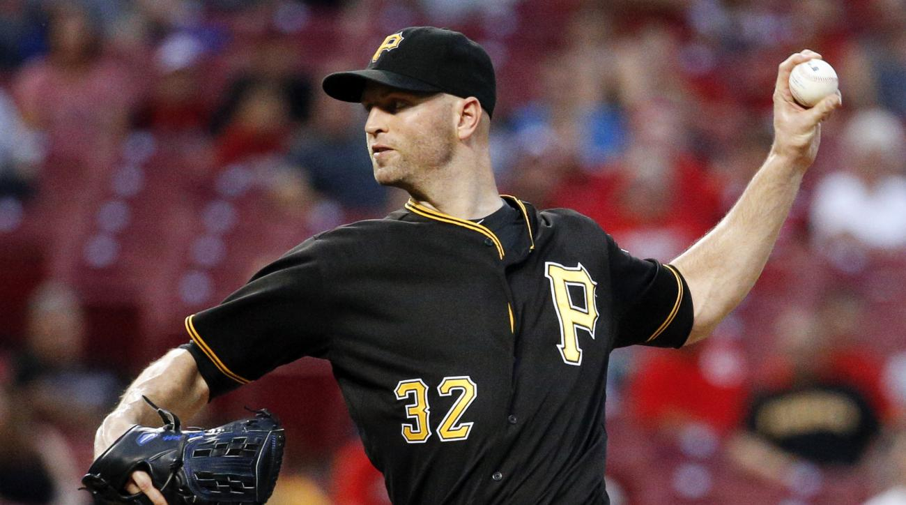 FILE - In this Sept. 9, 2015, file photo, Pittsburgh Pirates starting pitcher J.A. Happ throws during the second inning of a baseball game against the Cincinnati Reds, in Cincinnati. The left-hander agreed to a $36 million, three-year contract on Friday,