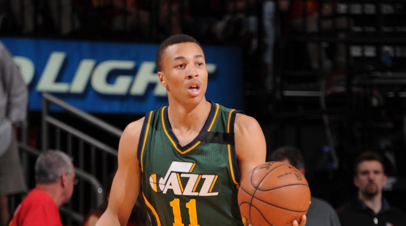 HOUSTON, TX - APRIL 15: Dante Exum #11 of the Utah Jazz handles the ball against the Houston Rockets on April 15, 2015 at the Toyota Center in Houston, Texas. (Photo by Bill Baptist/NBAE via Getty Images)