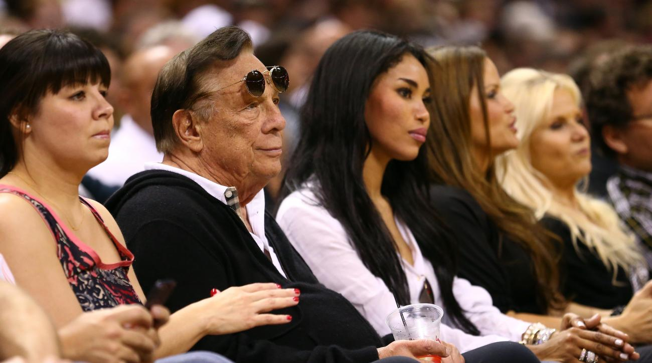 FILE - AUGUST 05: Former Clippers owner Donald Sterling has filed for divorce from his wife of almost 60 years, Shelly Sterling. SAN ANTONIO, TX - MAY 19:  (2nd L) Team owner Donald Sterling of the Los Angeles Clippers and V. Stiviano watch the San Antoni