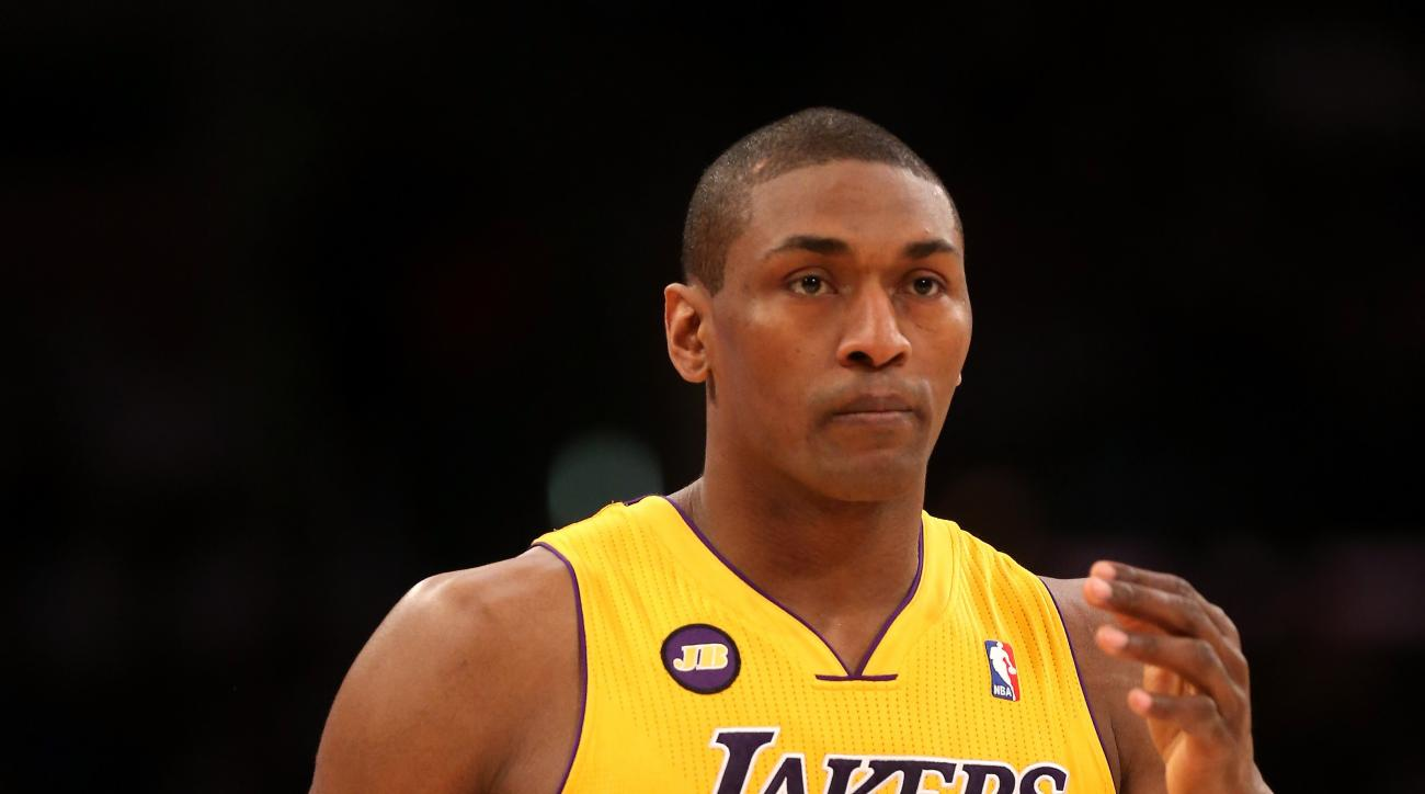 LOS ANGELES, CA - APRIL 09:  Metta World Peace #15 of the Los Angeles Lakers enters the game for the first time off the bench against the New Orleans Hornets at Staples Center on April 9, 2013 in Los Angeles, California. The Lakers won 104-96.  (Photo by