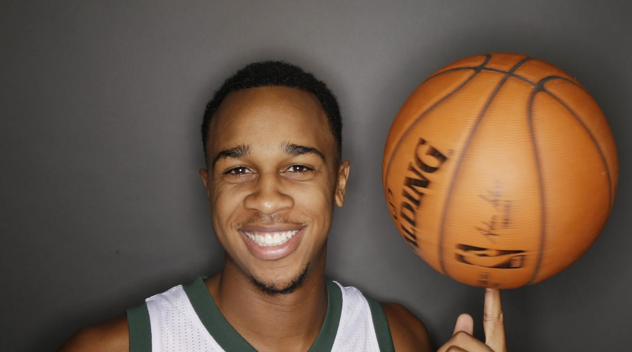 Milwaukee Bucks' John Henson poses for a picture during the team's NBA basketball media day Monday, Sept. 28, 2015, in St. Francis, Wis. (AP Photo/Morry Gash)