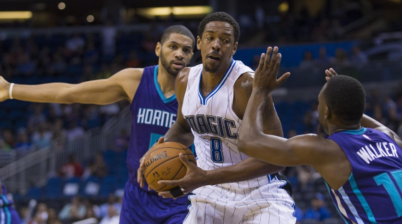 Orlando Magic forward Channing Frye (8) is defended by Charlotte Hornets forward Nicolas Batum (5) and Charlotte Hornets guard Kemba Walker (15) during the first half of an NBA basketball game in Orlando, Fla., Saturday, Oct. 3, 2015. (AP Photo/Willie J.