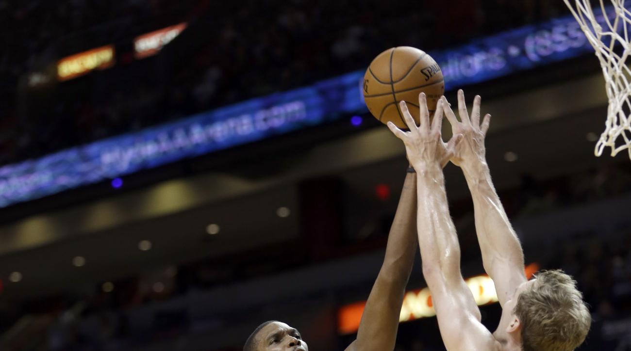 Miami Heat forward Chris Bosh (1) shoots against Charlotte Hornets forward Cody Zeller (40) in the first half of an NBA preseason basketball game, Sunday, Oct. 4, 2015, in Miami. The Hornets won 90-77. (AP Photo/Alan Diaz)