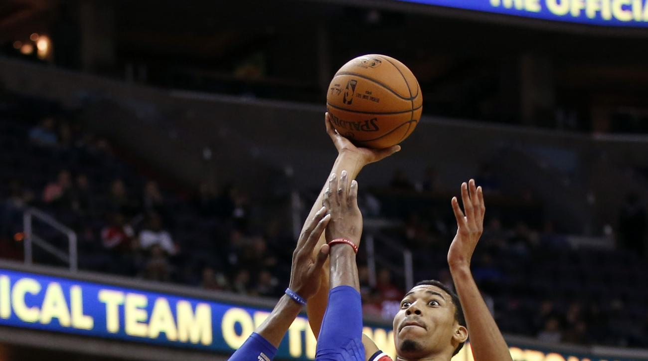 Washington Wizards forward Otto Porter Jr. (22) shoot over Philadelphia 76ers forward Robert Covington (33) in the second half of an NBA preseason basketball game Tuesday, Oct. 6, 2015, in Washington. The Wizards won 129-95. (AP Photo/Alex Brandon)
