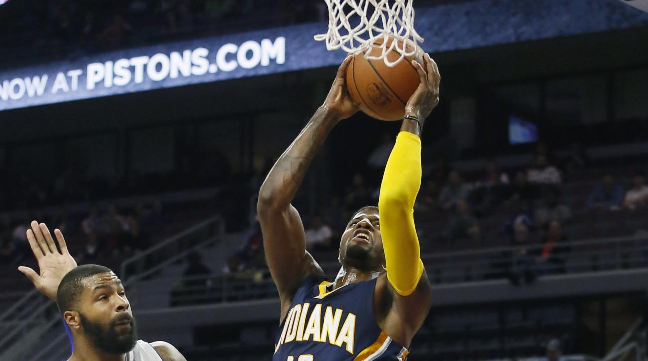 CORRECTS TO PAUL GEORGE FROM GEORGE PAUL- Indiana Pacers' Paul George (13) goes to the basket against Detroit Pistons' Marcus Morris, left, during the first half of an NBA preseason basketball game Tuesday, Oct. 6, 2015, in Auburn Hills, Mich. (AP Photo/D