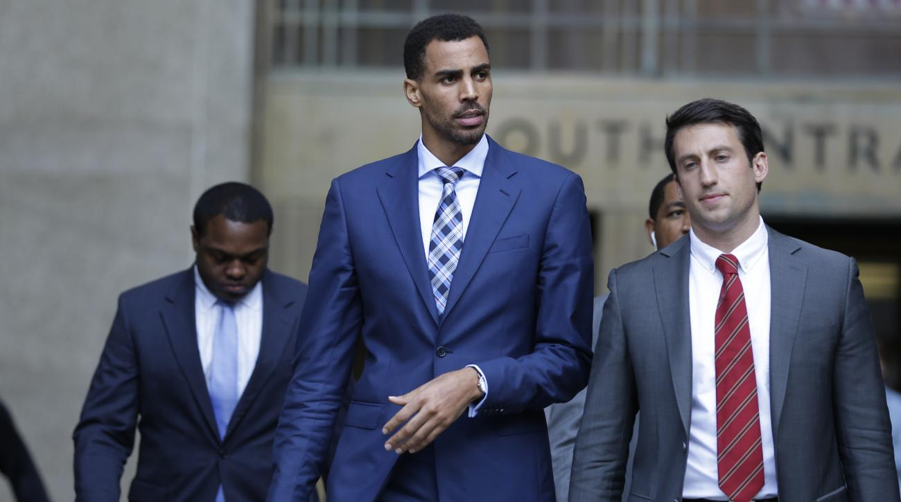 Thabo Sefolosha, center, leaves criminal court in New York, Wednesday, Oct. 7, 2015. The professional basketball player was about to give a handout to a man asking for money when police officers took him to the ground and arrested him, a former teammate t