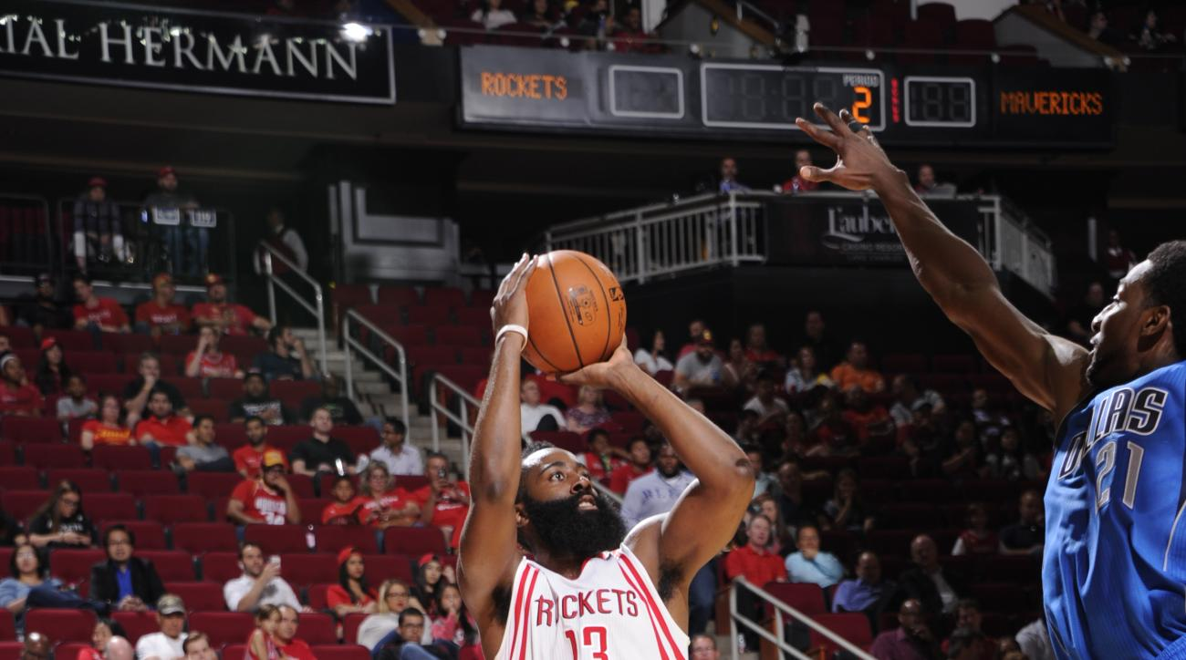 HOUSTON, TX - OCTOBER 7:  James Harden #13 of the Houston Rockets shoots the ball against the Dallas Mavericks during a preseason game on October 7, 2015 at the Toyota Center in Houston, Texas. (Photo by Bill Baptist/NBAE via Getty Images)