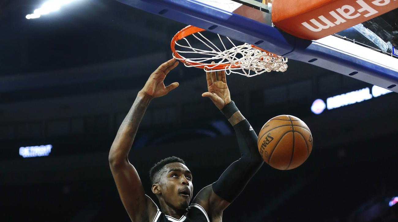 Brooklyn Nets forward Quincy Miller (20) dunks against the Detroit Pistons in the first half of an NBA preseason basketball game in Auburn Hills, Mich., Thursday, Oct. 8, 2015. (AP Photo/Paul Sancya)