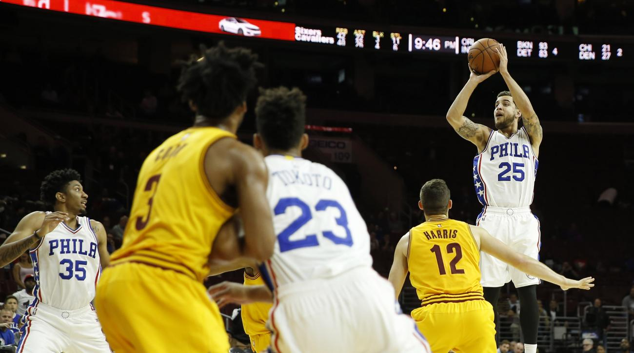 Philadelphia 76ers' Scottie Wilbekin (25) goes up for the go-ahead shot over Cleveland Cavaliers' Joe Harris (12) during final seconds of the second half of an NBA preseason basketball game, Thursday, Oct. 8, 2015, in Philadelphia. Philadelphia won 115-11