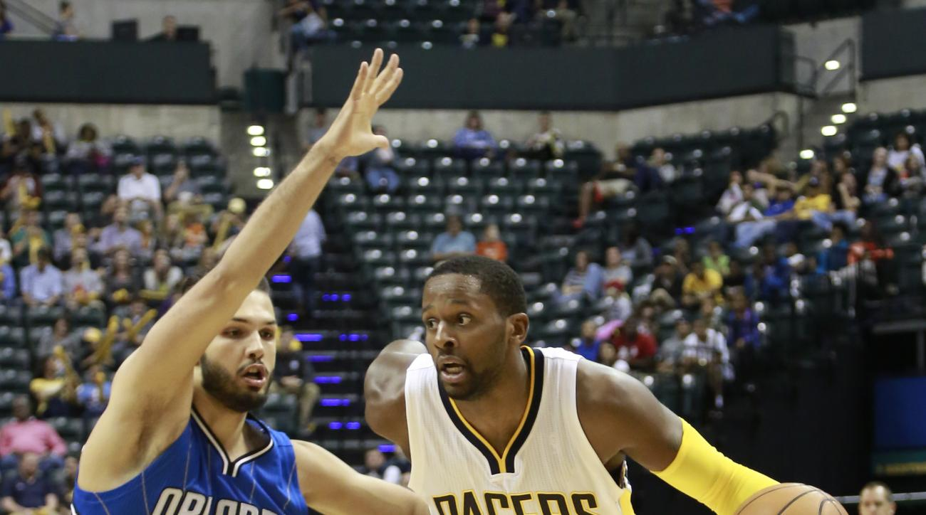 Indiana Pacers forward C.J. Miles (0) drives past Orlando Magic guard Evan Fournier in the second half of an NBA preseason basketball game, Thursday, Oct. 8, 2015, in Indianapolis. Indiana won 97-92. (AP Photo/R Brent Smith)