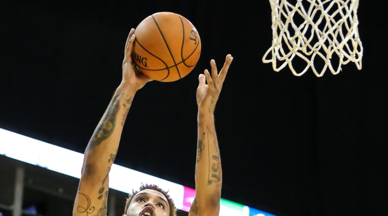 Atlanta Hawks forward Mike Scott (32) lays the ball to the basket during the second half of an NBA preseason basketball game against the New Orleans Pelicans in Jacksonville, Fla., Friday, Oct. 9, 2015. The Hawks won 103-93. (AP Photo/Gary McCullough)