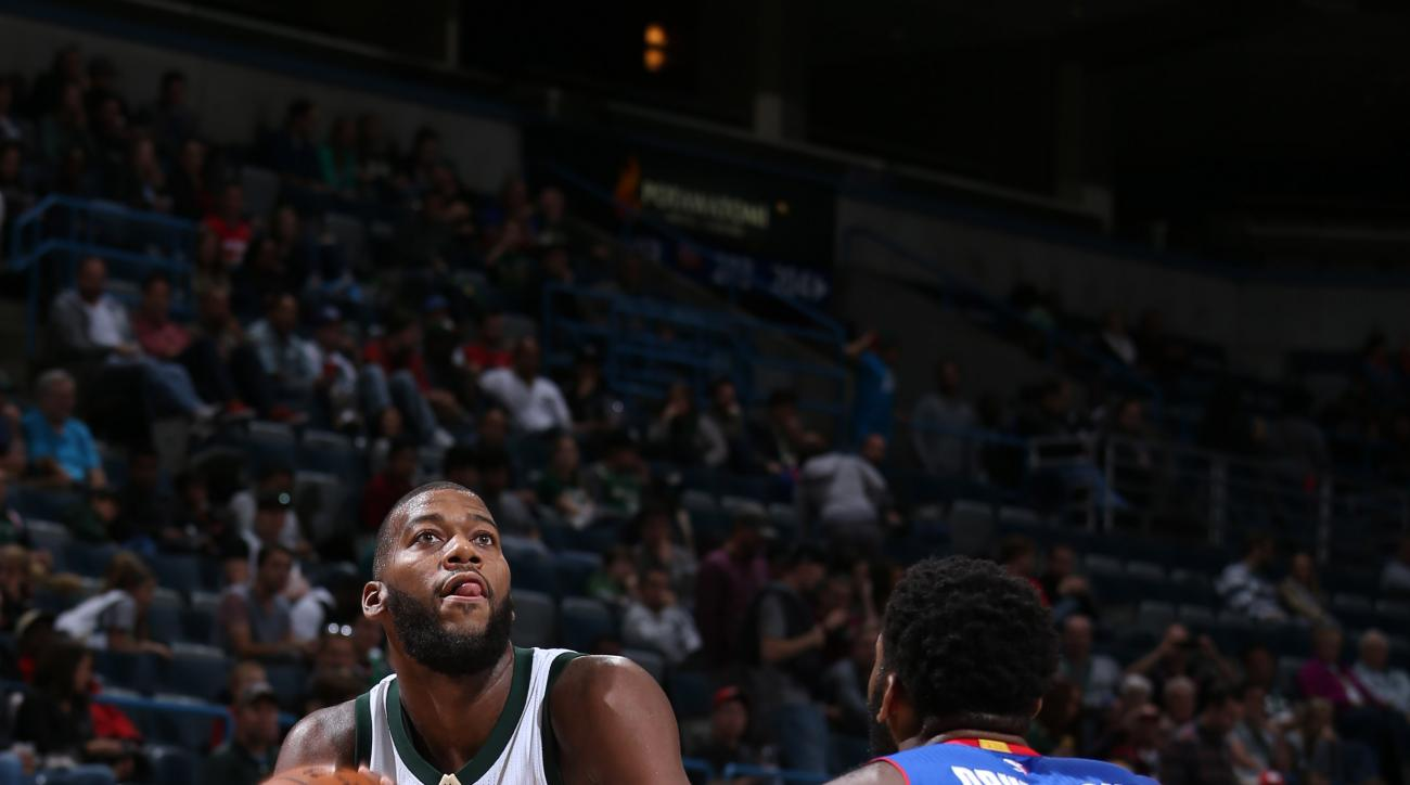 MILWAUKEE, WI - OCTOBER 10:  Greg Monroe #15 of the Milwaukee Bucks handles the ball against Andre Drummond #0 of the Detroit Pistons on October 10, 2015 at the BMO Harris Bradley Center in Milwaukee, Wisconsin. (Photo by Gary Dineen/NBAE via Getty Images