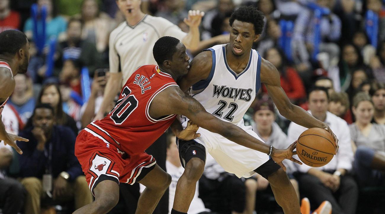 Chicago Bulls' Tony Snell, left, defends against Minnesota Timberwolves' Andrew Wiggins (22) during the second half of an NBA preseason basketball game, Saturday, Oct. 10, 2015, in Winnipeg, Manitoba. (John Woods/The Canadian Press via AP) MANDATORY CREDI