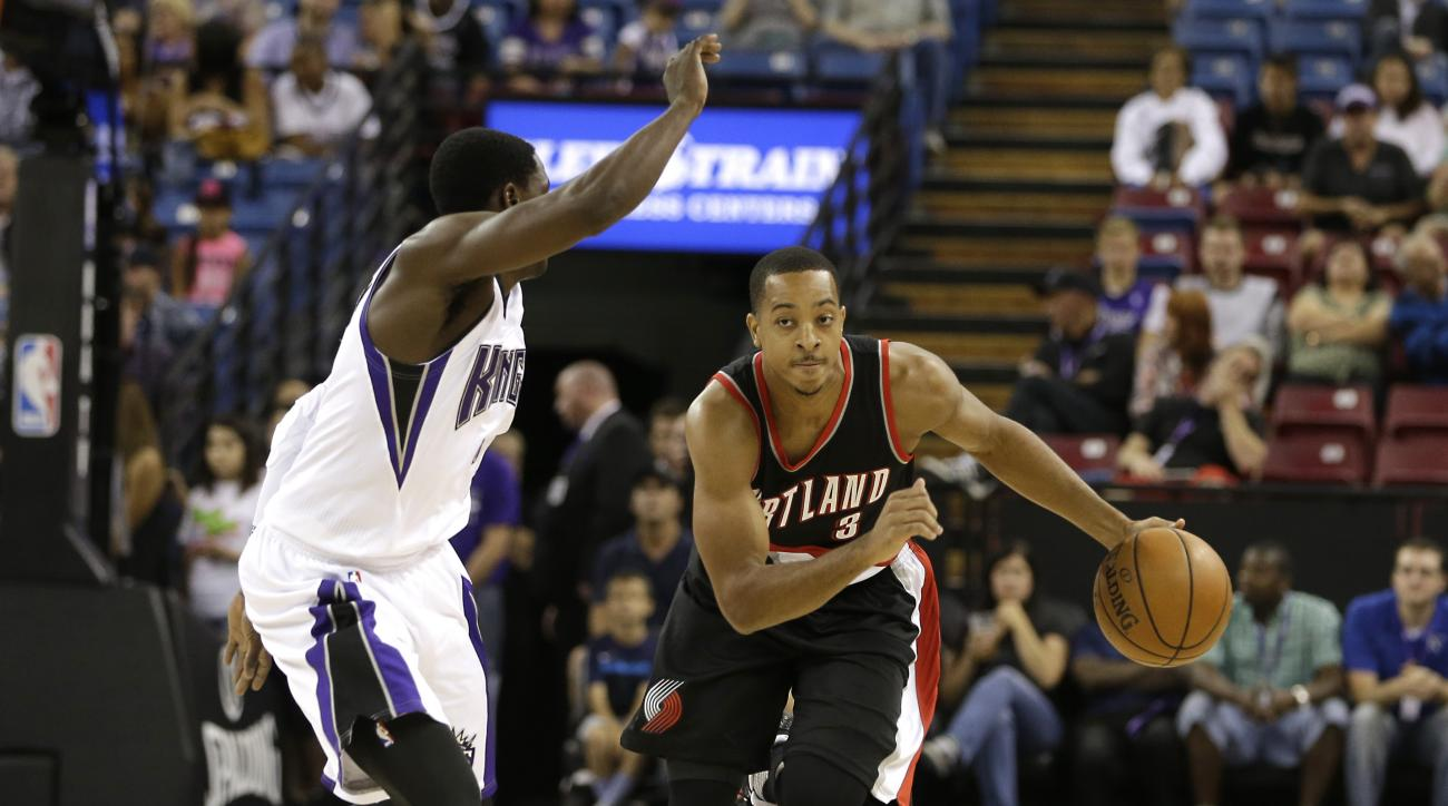 Portland Trail Blazers guard C.J. McCollum, right, brings the ball down court against Sacramento Kings guard Darren Collison during the first half of an NBA basketball game in Sacramento, Calif., Saturday, Oct. 10, 2015. The Kings won 94-90. (AP Photo/Ric