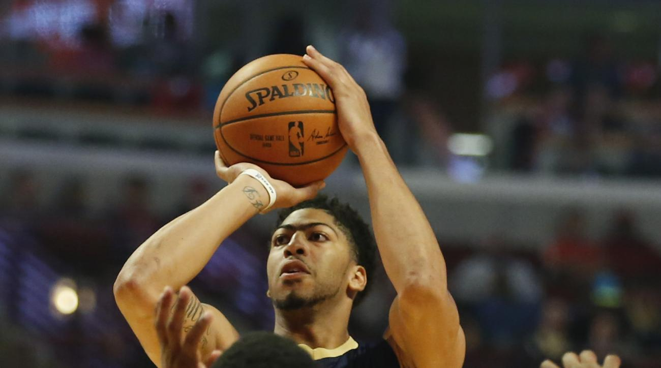 New Orleans Pelicans forward Anthony Davis shoots over Chicago Bulls guard Aaron Brooks during the first half of an NBA preseason basketball game, Monday, Oct. 12, 2015, in Chicago. (AP Photo/Kamil Krzaczynski)