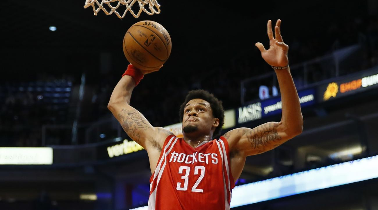 Houston Rockets' K.J. McDaniels (32) drives against the Phoenix Suns during the first half of an NBA preseason basketball game, Tuesday, Oct. 13, 2015, in Phoenix. (AP Photo/Matt York)