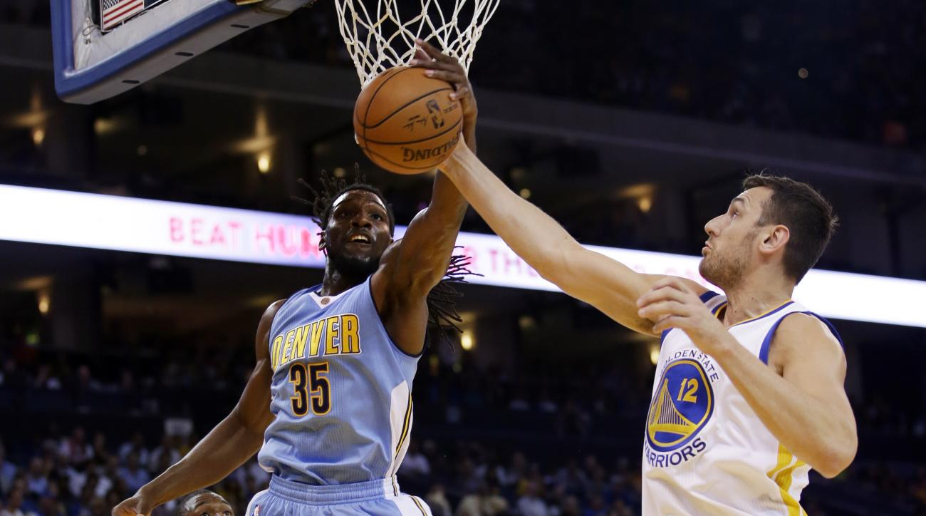 Denver Nuggets' Kenneth Faried (35) battles for a rebound against Golden State Warriors' Andrew Bogut (12) during the first half of an NBA preseason basketball game Tuesday, Oct. 13, 2015, in Oakland, Calif. (AP Photo/Marcio Jose Sanchez)