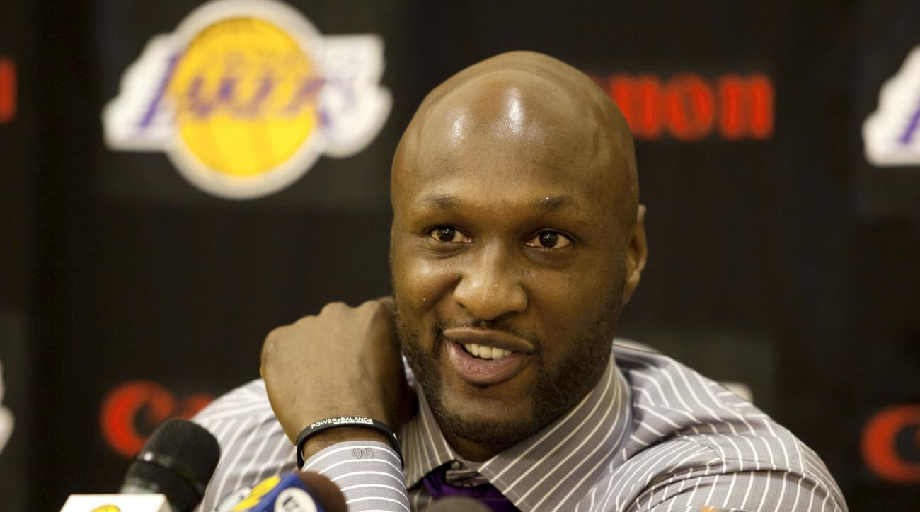 FILE - In this July 31, 2009, file photo, Los Angeles Lakers' Lamar Odom speaks to the media during a news conference after the Lakers signed Odom to a multi-year NBA basketball contract, in El Segundo, Calif. Odom spent most of his 14-year NBA career in