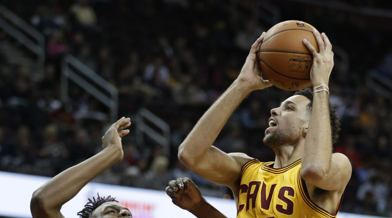 Cleveland Cavaliers' Austin Daye (15) drives to the basket against Indiana Pacers' Myles Turner (33) in the second half of an NBA preseason basketball game, Thursday, Oct. 15, 2015, in Cleveland. The Pacers won 107-85. (AP Photo/Tony Dejak)