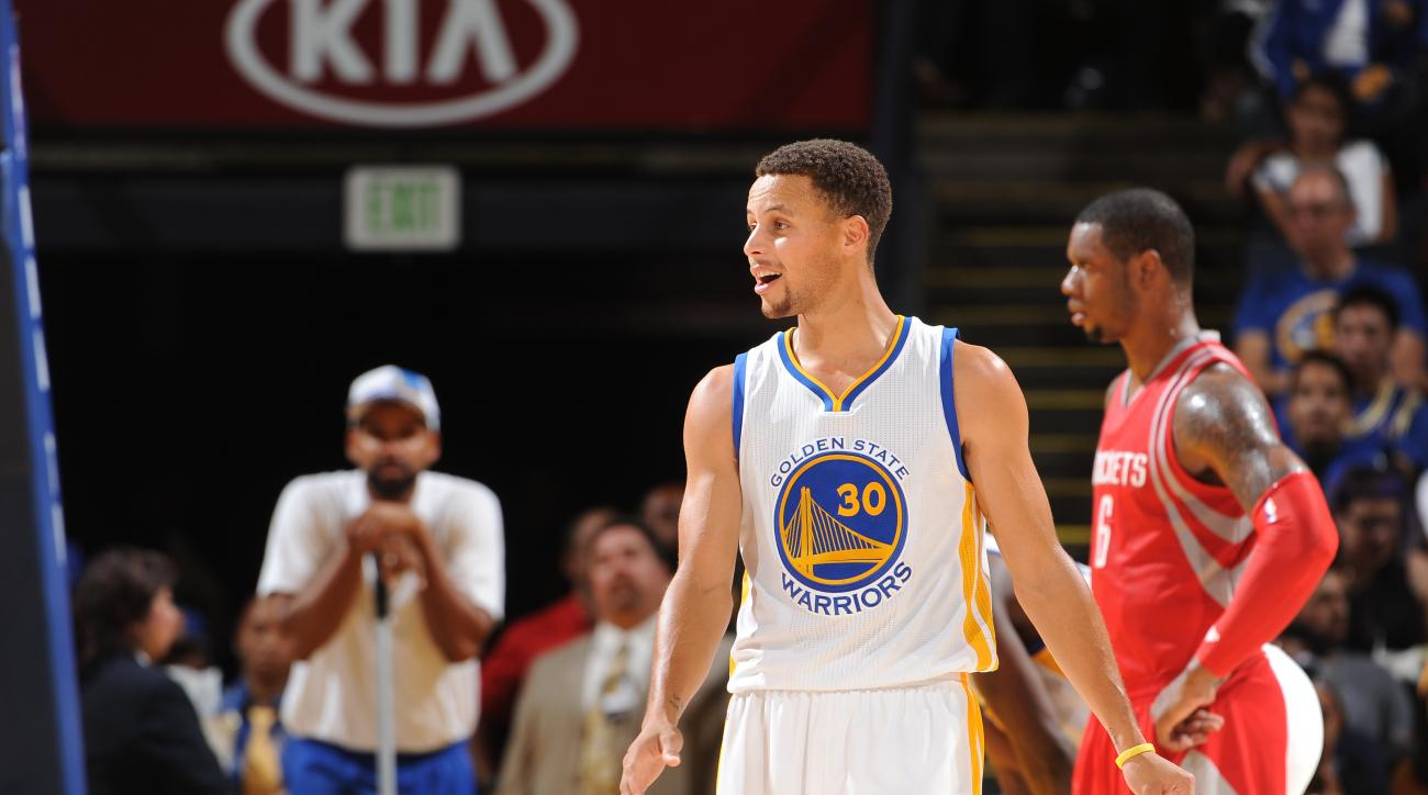 OAKLAND, CA - OCTOBER 15:  Stephen Curry #30 of the Golden State Warriors looks on during the game against the Houston Rockets on October 15, 2015 at Oracle Arena in Oakland, California. (Photo by Noah Graham/NBAE via Getty Images)