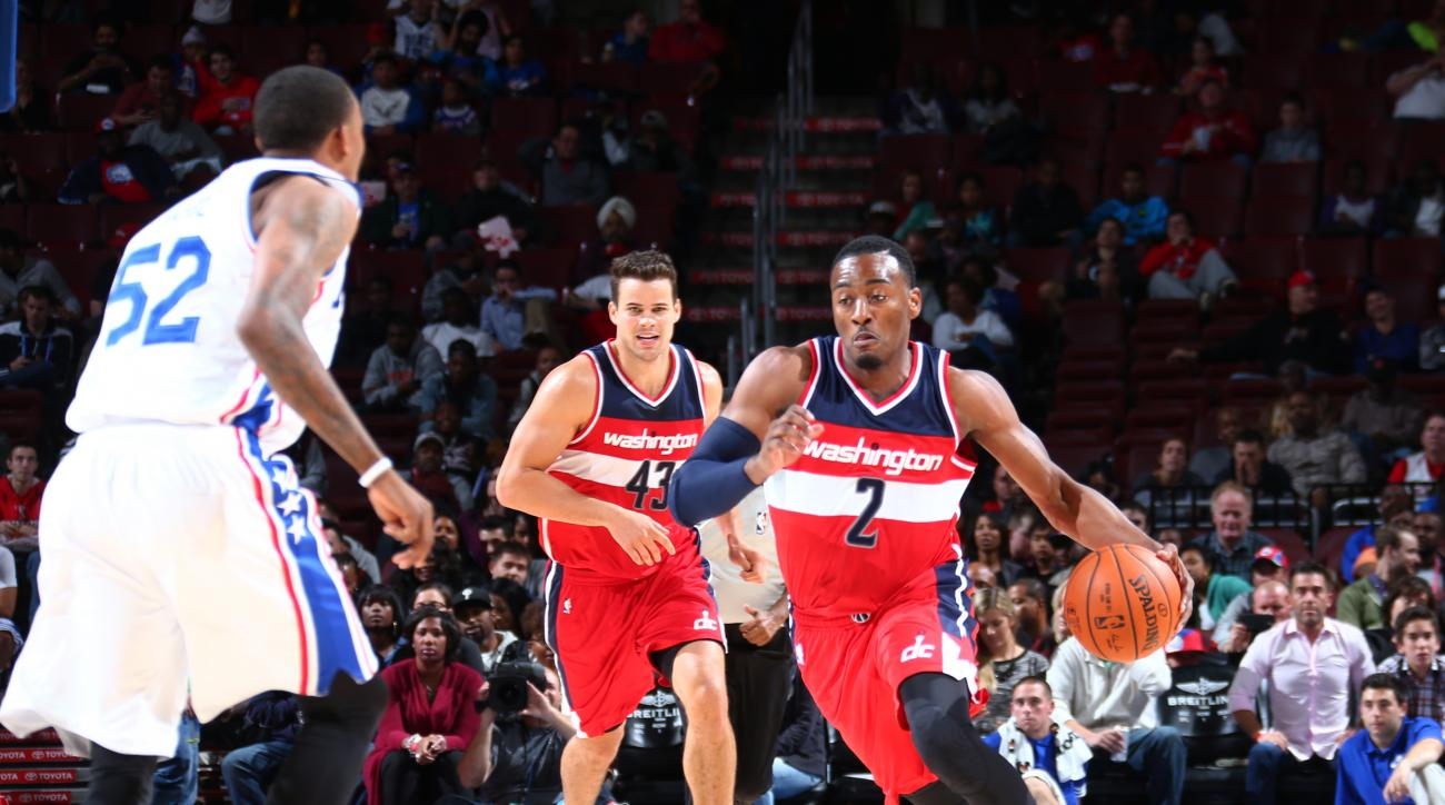 PHILADELPHIA, PA - OCTOBER 16: John Wall #2 of the Washington Wizards drives to the basket against the Philadelphia 76ers during the preseason game on October 16, 2015 at Wells Fargo Center in Philadelphia, Pennsylvania. (Photo by Ned Dishman/NBAE via Get