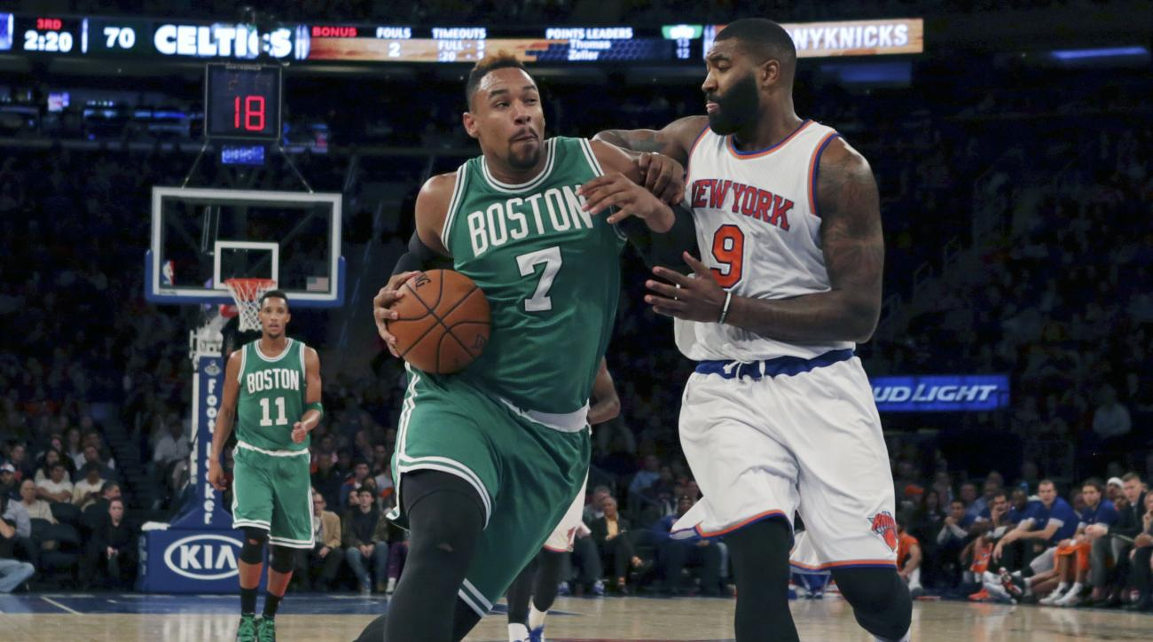 Boston Celtics forward Jared Sullinger (7) is fouled by New York Knicks forward Kyle O'Quinn during the second half of a preseason NBA basketball game at Madison Square Garden on Friday, Oct. 16, 2015, in New York. The Knicks defeated the Celtics 101-95.